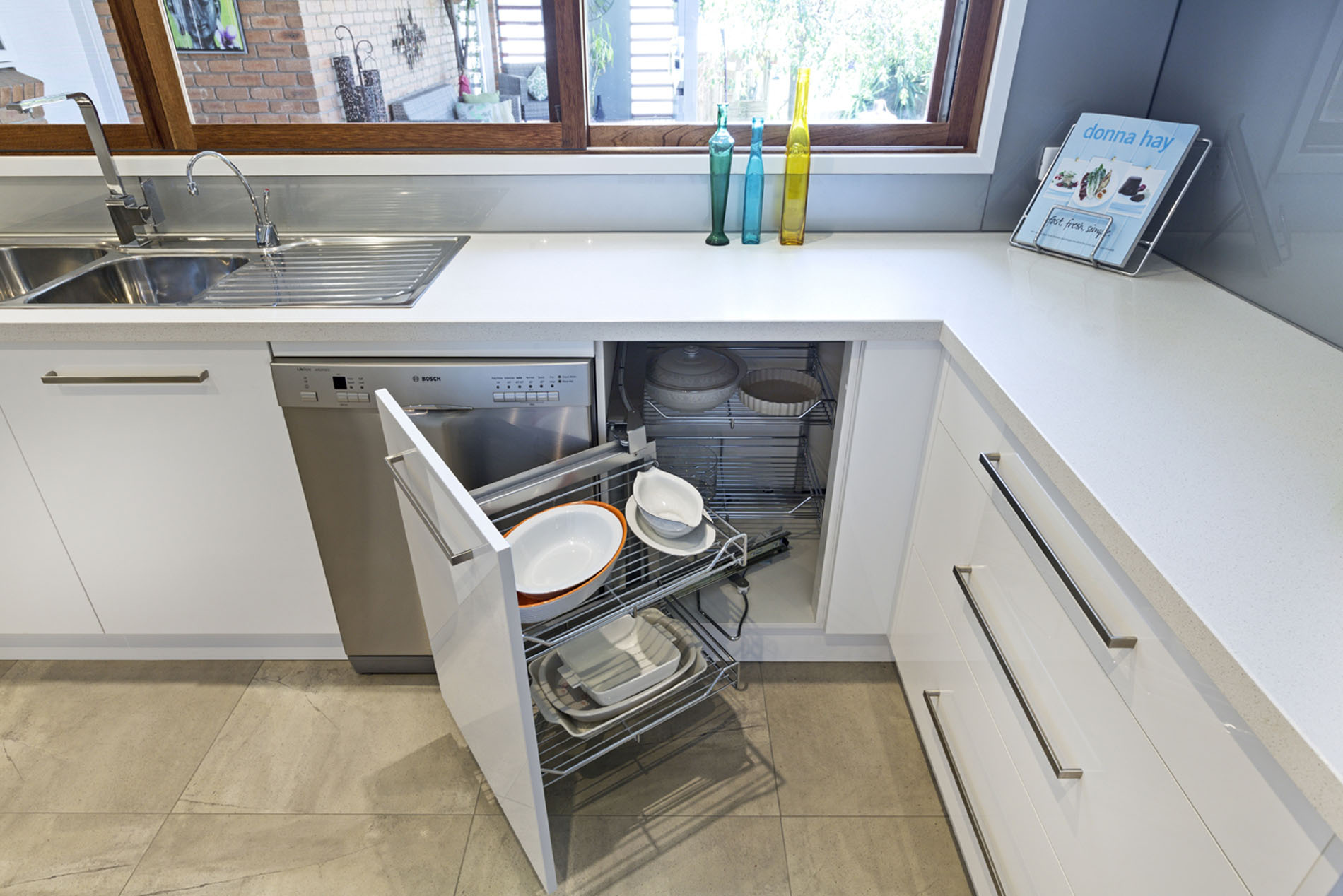 kitchen with fold out plate storage cupboard