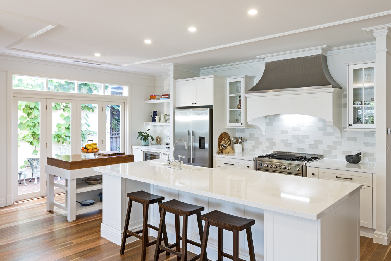 white open plan kitchen with two kitchen islands